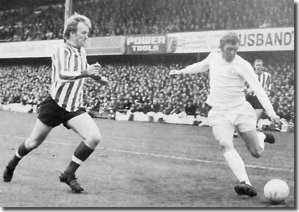 Birthday boy Mick Jones takes on Southampton's Jimmy Gabriel at the Dell on 24 April - Jones scored twice in a 2-0 victory