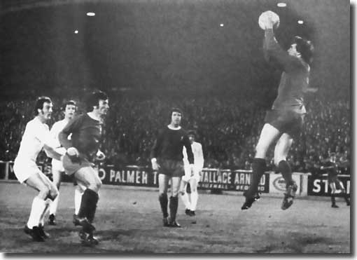 Paul Madeley is on hand but Liverpool keeper Ray Clemence saves confidently during the Fairs Cup semi final second leg on 28 April