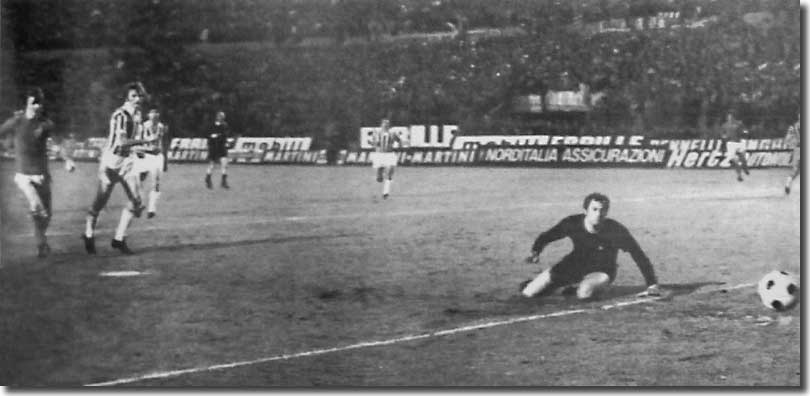 Paul Madeley (out of picture) scores in Turin in the first leg of the Fairs Cup final