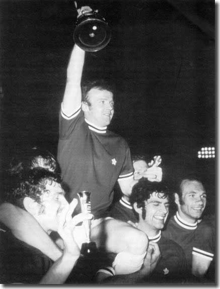 Silverware at last - Billy Bremner hoists the Fairs Cup trophy