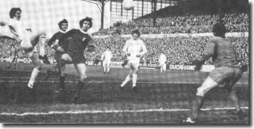 Allan Clarke clips the ball over Ray Clemence to give Leeds the lead