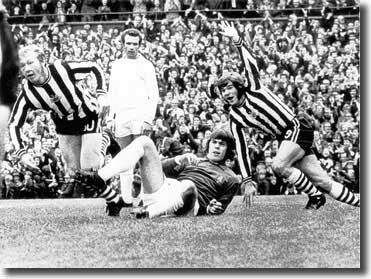 Newcastle's John Tudor has just headed past David Harvey to put his side 2-1 ahead with Malcolm Macdonald joining in the celebration