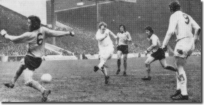 Mick Jones looks on as Billy Bremner thrashes home the only goal of the Cup semi-final against Wolves
