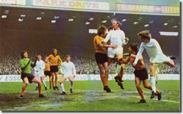 Jack Charlton soars above Wolves' Derek Dougan in the Cup semi-final