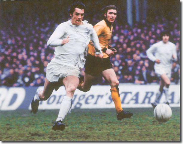 Joe Jordan races away from Wolves' John McAlle - the Scot came off the bench after half an hour to replace Jack Charlton