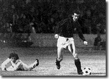 Cherry looks on forlornly as his slip allows Albertino Bigon to attack the United goal, but David Harvey saved his effort