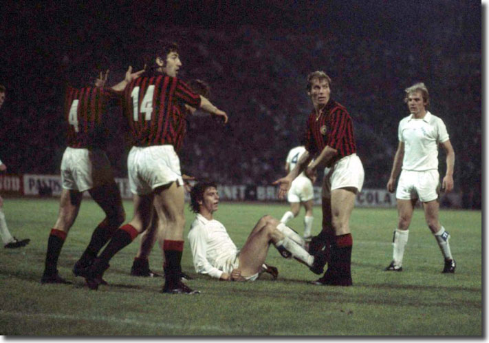 Italian defenders protest after an aerial challenge from Joe Jordan - the United striker was booked