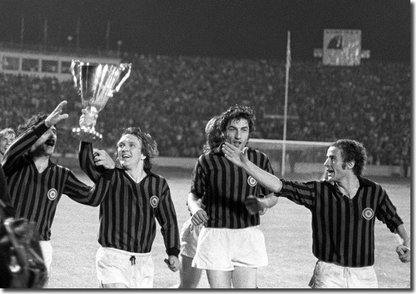 Milan players Turone, Sogliano, Anquilletti and Chiarugi joyously parade the trophy at the end but United will never accept that their success was anything other than a travesty of justice