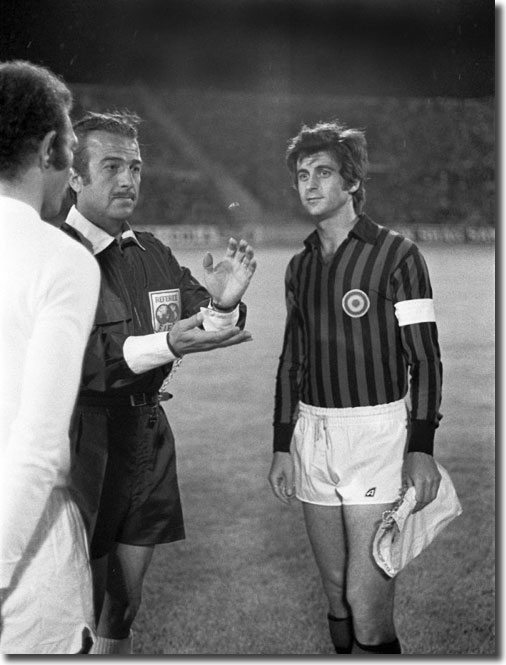 Greek referee Christos Michas tosses the coin at the start of the game with Paul Reaney and Gianni Rivera