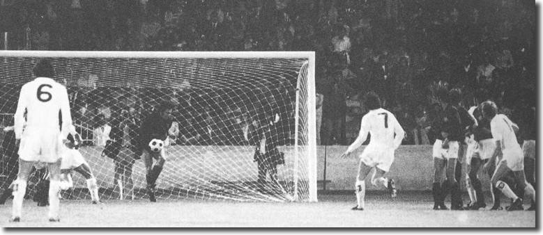 Milan keeper William Vecchi gathers a United shot as Lorimer and Yorath look to follow in