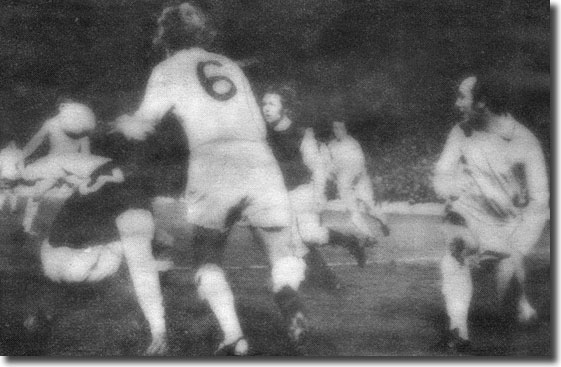 Hibs' Eric Schaedler and Jim Black deny Terry Yorath and Roy Ellam in one Leeds attack