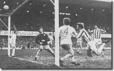Stoke's Dennis Smith crashes in a superb winner to end United's unbeaten run in 1974