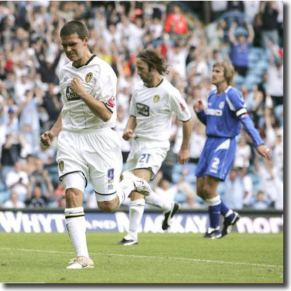 David Healy celebrates his cool penalty winner in United's opener against Millwall