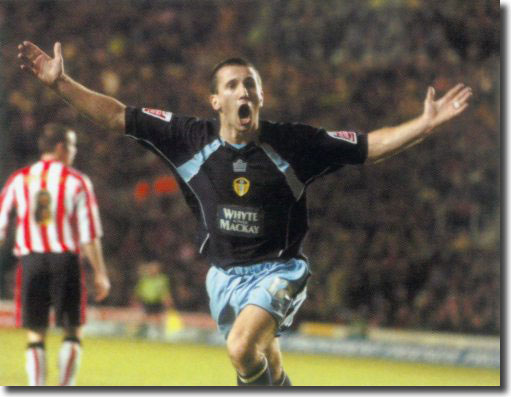 Liam Miller celebrates his late winner at St Mary's to settle an incredible match