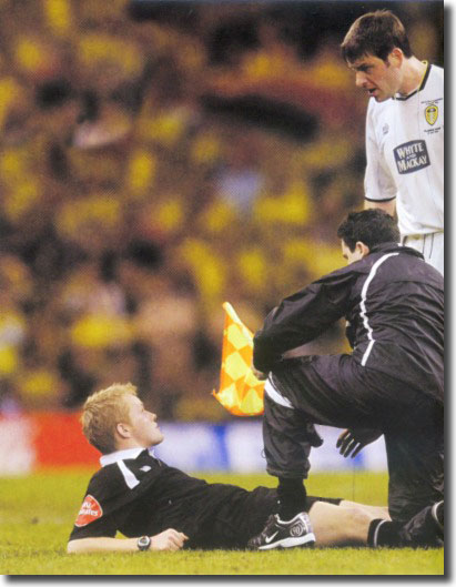 Paul Butler is incredulous as the referee's assistant receives treatment