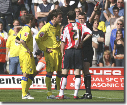Referee Tony Bates sends off Alan Thompson at Southampton on 21 April with David Healy looking on