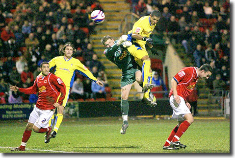 Jermaine Beckford leaps to beat the Crewe keeper and score the only goal at Gresty Road on 14 January