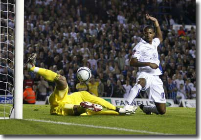 Jermaine Beckford beats the keeper to the ball, but the goal is chalked off