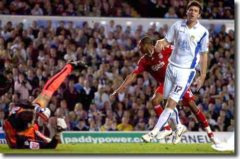 David Ngog turns away after scoring at Elland Road with Higgs and Michalik showing their disappointment