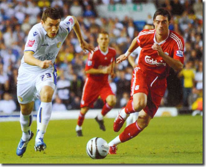 Rob Snodgrass chases for the ball with Liverpool's Albert Riera - the Scottish wide man had a wonderful night, pulling the Reds' defence apart