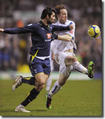 Luciano Becchio battles it out with Tottenham's Vedran Corluka