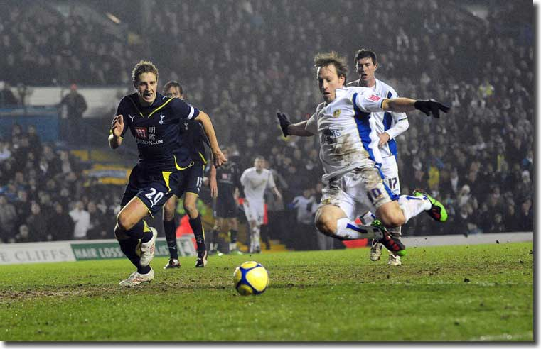 Luciano Becchio leaps on the loose ball to draw United level against Tottenham