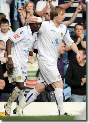 Max Gradel celebrates with Luciano Becchio after scoring the first goal against Southend on 10 April