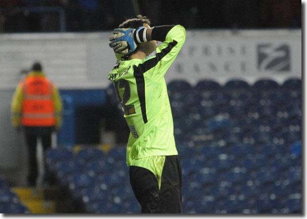 Rachubka holds his head after Coventry's Richard Wood equalises in injury time