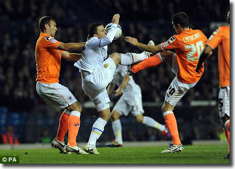 Ross McCormack is outnumbered by Blackpool's Ian Evatt and Craig Cathcart