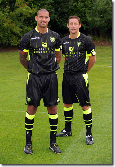 Paddy Kisnorbo and new midfielder Michael Brown model the 2011/12 away kt