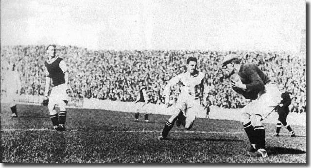 Tom Jennings in action against Villa 1926-27.  Jennings hit a record 35 goals for United as the club lost its First Division status