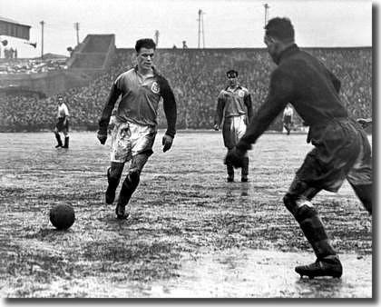 Charles ensures goalkeeper Harry Searson takes the ball in the Cup against Bolton in 1950