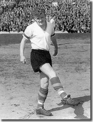 Billy Bremner warms up for the game against Middlesbrough in September, complete with new look kit and fearsome boots