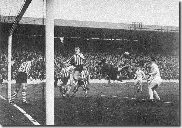 7 March 1964 - the ball is on its way to Ian Lawson (second from right) who promptly shot into the net to open the scoring in a 3-1 victory over Southampton. Alan Peacock is the United man on the right