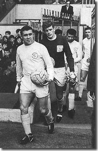Bobby Collins leads out the United side into the brave new world of the First Division