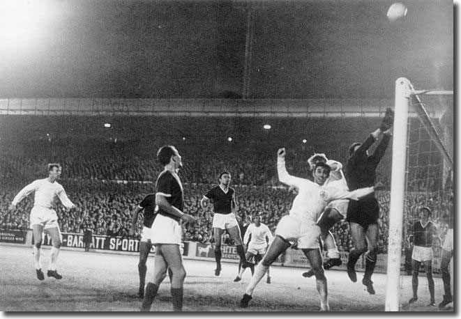 Dinamo goalkeeper Skoric fists the ball over the bar under pressure from Belfitt and Bremner during another United raid at Elland Road