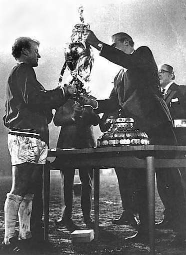 Billy Bremner being presented with the trophy for the League title win in 1969