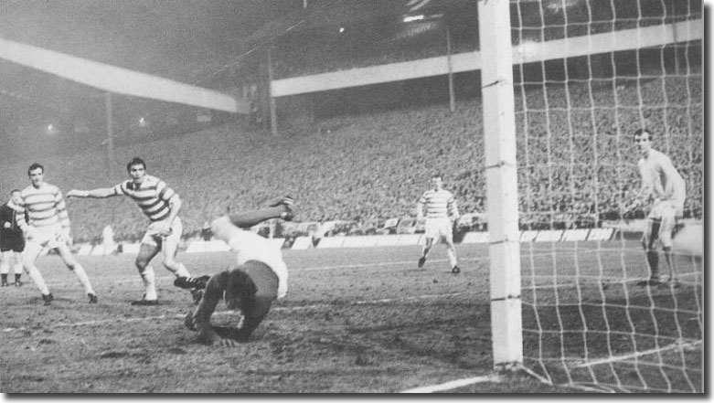David Harvey is beaten and Paul Madeley can only watch as this strike from Celtic's Bobby Murdoch (out of picture) enters the net to give the Scots a 3-1 aggregate lead