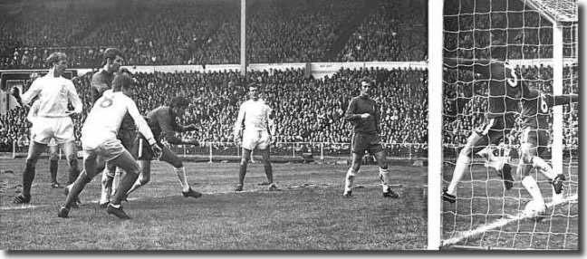 Charlton (far left) watches as his header beats two Chelsea defenders on the line to give Leeds the lead in the FA Cup final