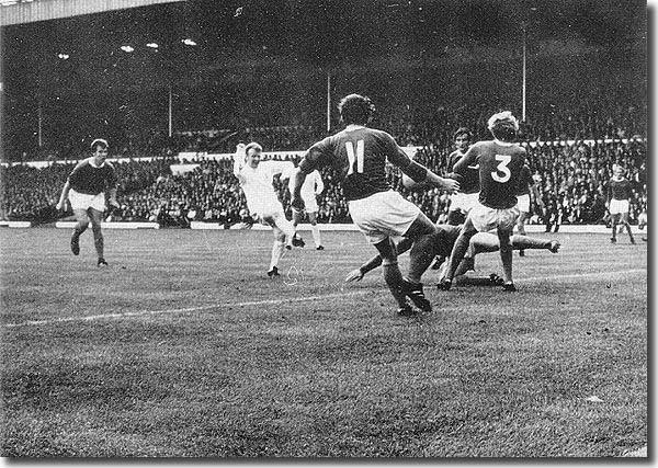Billy Bremner slots home a goal in the 3-2 defeat of champions Everton