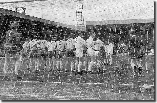 Referee Ray Tinkler struggles in vain to get the Albion wall to retreat the required ten yards