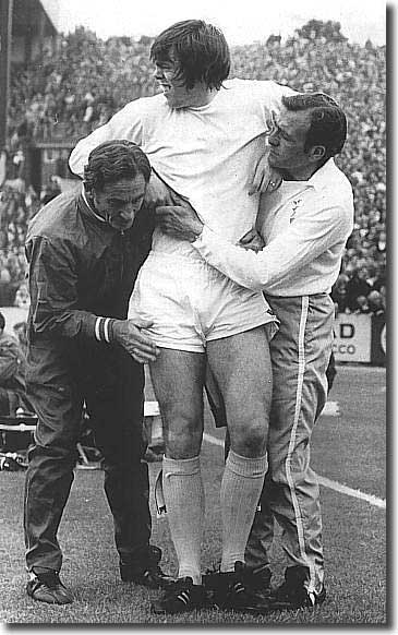 Les Cocker and the Chelsea trainer carry off David Harvey during the opening game of 1972/73 against Chelsea.  Peter Lorimer went in goal and Leeds lost 4-0