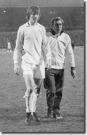 Les Cocker leads Allan Clarke off after his dismissal against Hajduk Split in the semi-finals - the dismissal left him suspended and out of the final against Milan