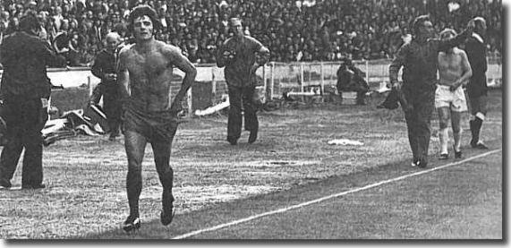 Shirtless Kevin Keegan and Billy Bremner take the long walk following their dismissal during the 1974 Charity Shield match