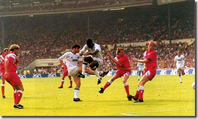 Cantona scoring his second and Leeds' third goal in the 4-3 victory over Liverpool in the 1992 Charity Shield match