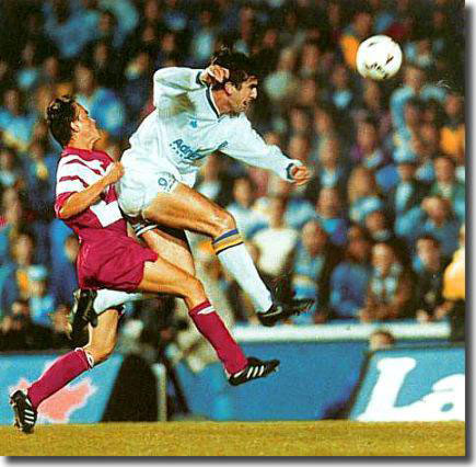 Cantona terrorises the Stuttgart defence in the match at Elland Road