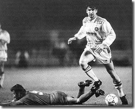 Leeds lost the first leg of their European Cup tie at Stuttgart 3-0 - Cantona here gives the Germans some concern
