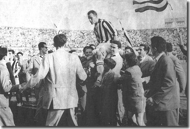 Charles is chaired off the pitch by jubilant fans after Juve's championship win in 1958