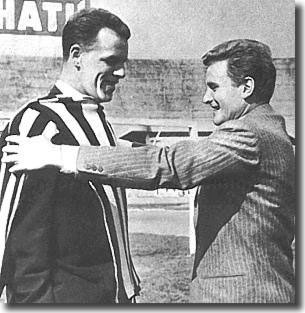 Juventus skipper Boniperti tries a Juventus shirt for size on his new team mate