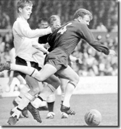 A young Allan Clarke of Fulham attempts to take out Billy Bremner during the clash at Craven Cottage on 17 September - the match finished 2-2